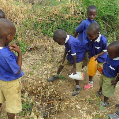Kids in Tanzania planting plants