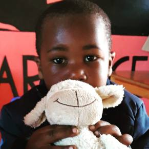 Young boy holding a stuffed animal
