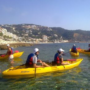 Volunteers kayaking in Spain