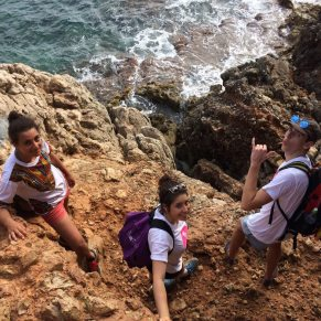 Volunteers on rocky shore in Spain