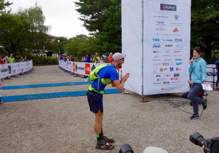 Working on my Japanese bow to the crowd at the finish. Photo by Meghan Hicks/iRunFar