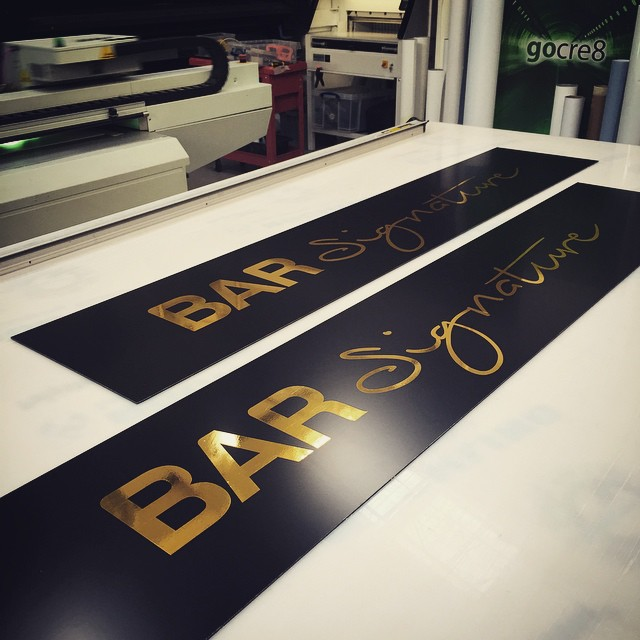 @bar_signature black and metallic gold signage in production