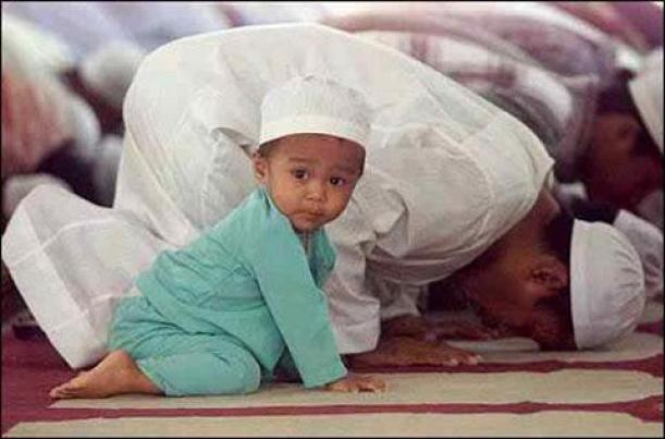 Praying baby in a Mosque