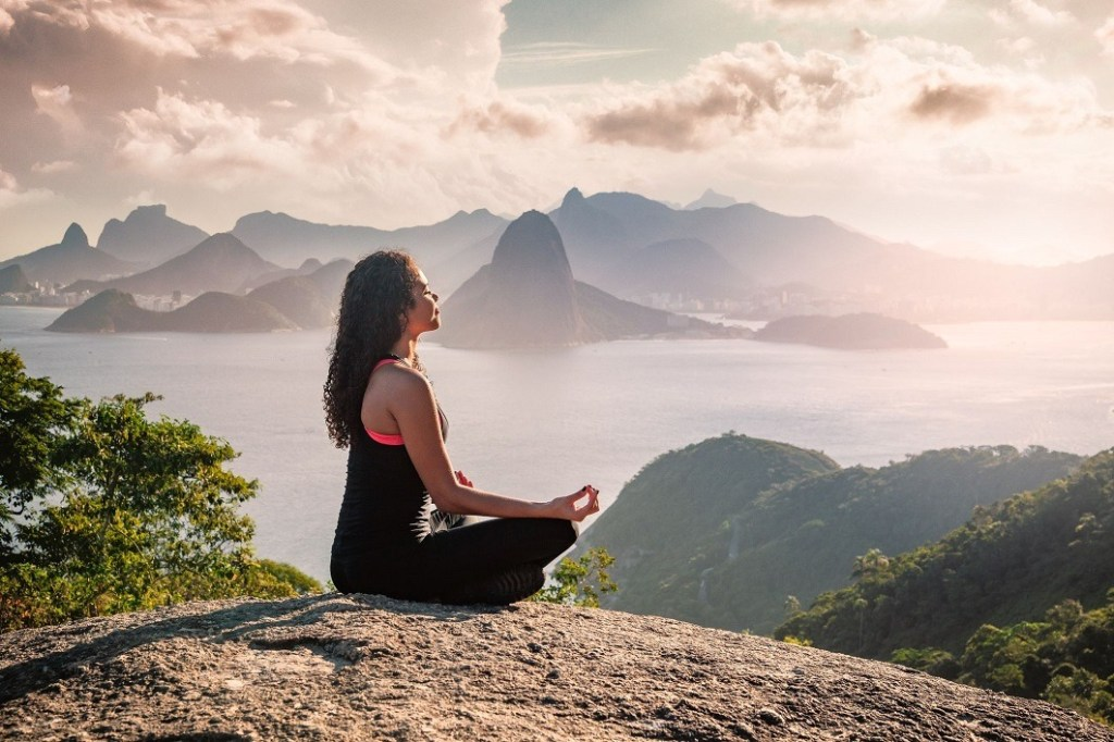 Woman meditating in the nature