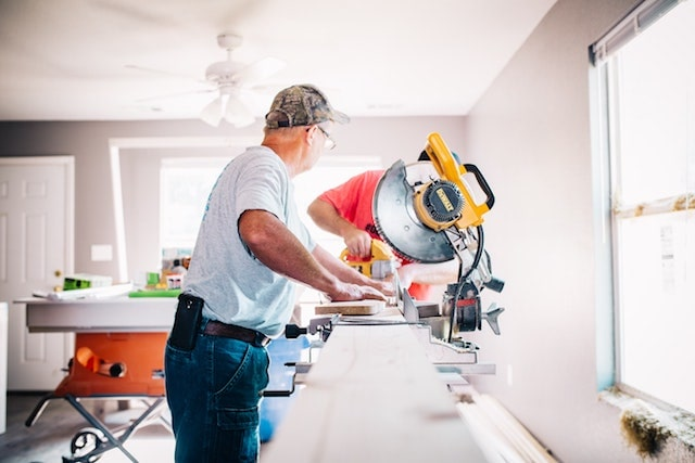 Contractors Working in Home with Saw