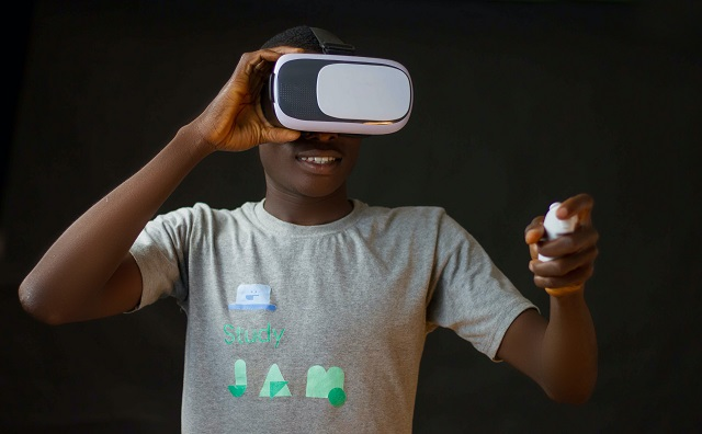 Man Using VR Headset And Remote