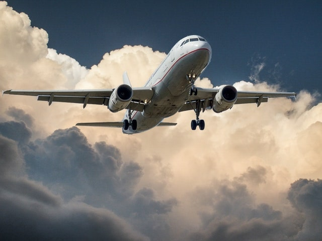 Help Your Company Go Green Plane In Clouds