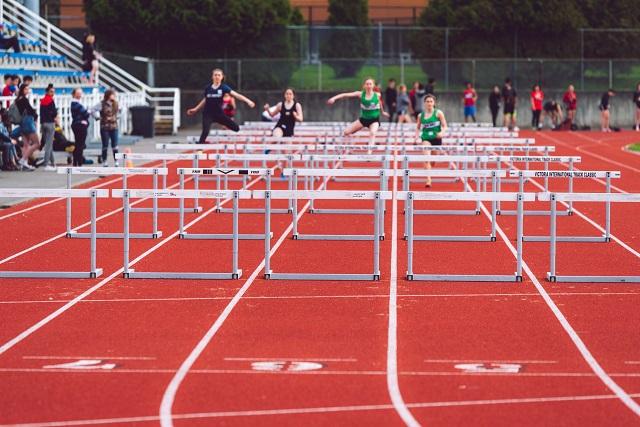 Racers running hurdles