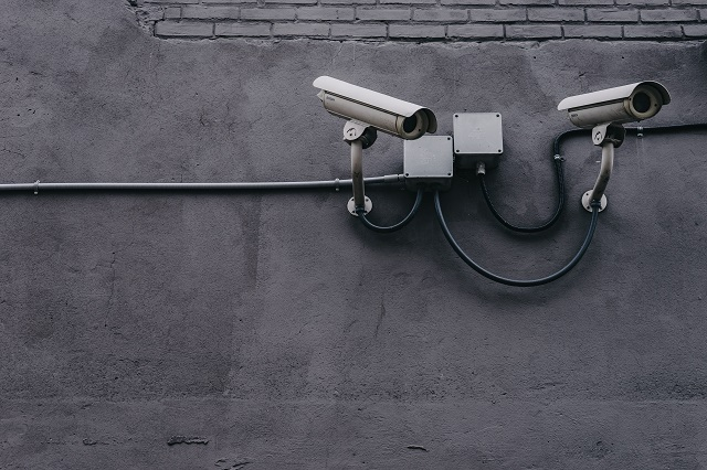 Security cameras on a grey concrete wall