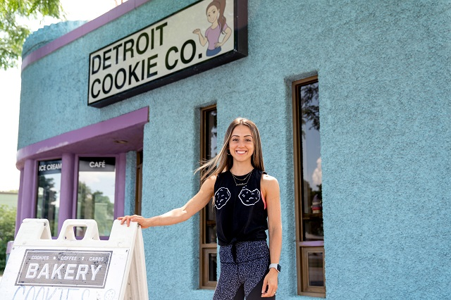 Lauren in front of her bakery and storefront