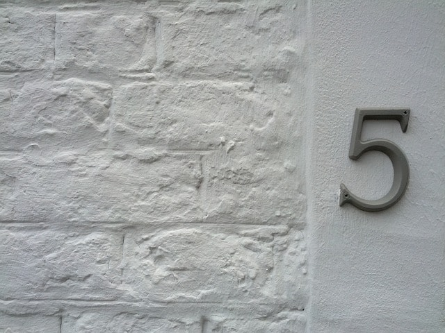 A white brick wall with the number 5 shown on the right