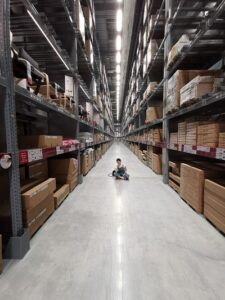 Person Sitting On Floor Of Warehouse
