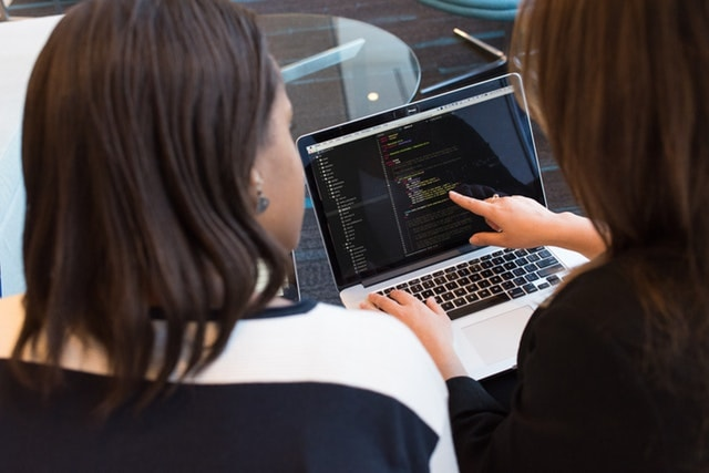 Two Women Working Together at Laptop