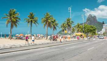 56985050 - people enjoying the sun on iconic ipanema beach in rio de janeiro.
