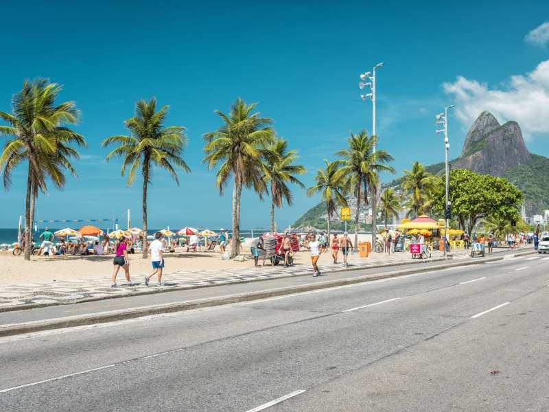 56985050 - people enjoying the sun on iconic ipanema beach in rio de janeiro.
