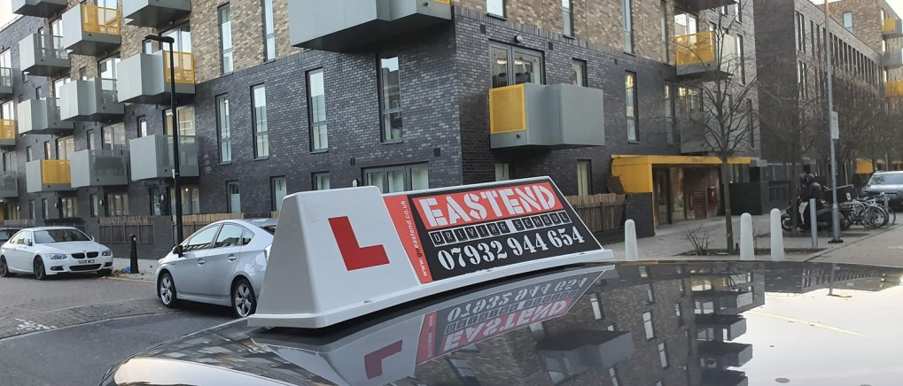 Driving school car roof board say Eastend Driving school