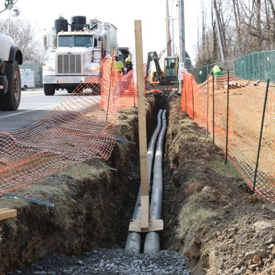 Trenching along roadside to locate existing gas line to allow new electrical lines to be installed