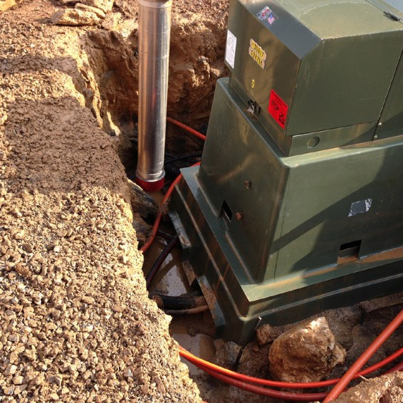 Carefully excavating and exposing utility lines to move transformer.