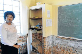 Mrs Nomawethu Mdingi showing where the fire started by thugs in the classroom Picture: RANDELL ROSKRUGE