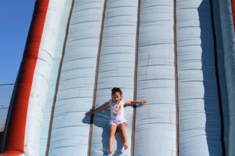 Grade 1 Hudson Park Primary School pupil Ezrah Casoojee, slides down the giant slide