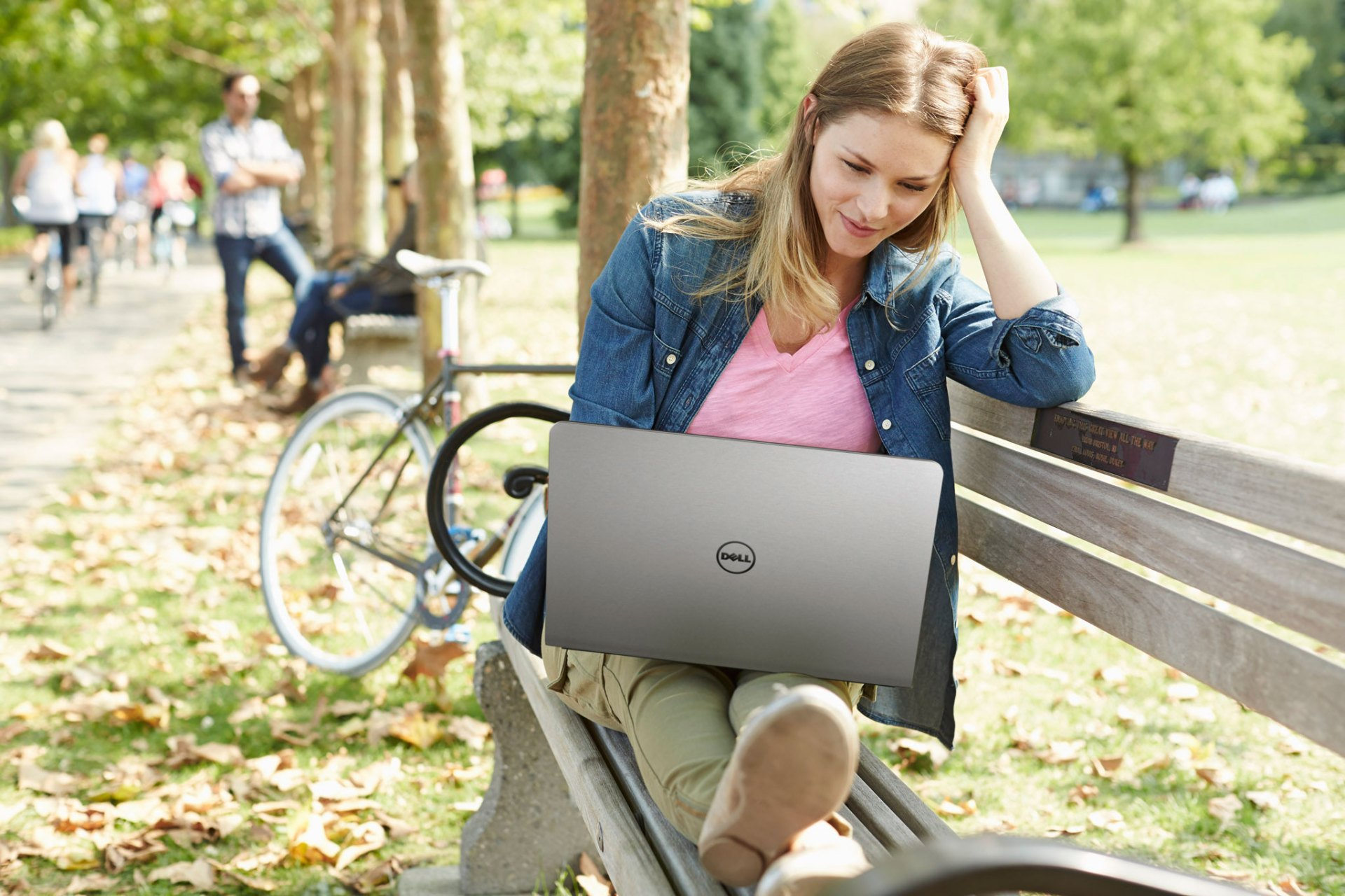 Female in Park using Inspiron 15 5000 Series Notebook