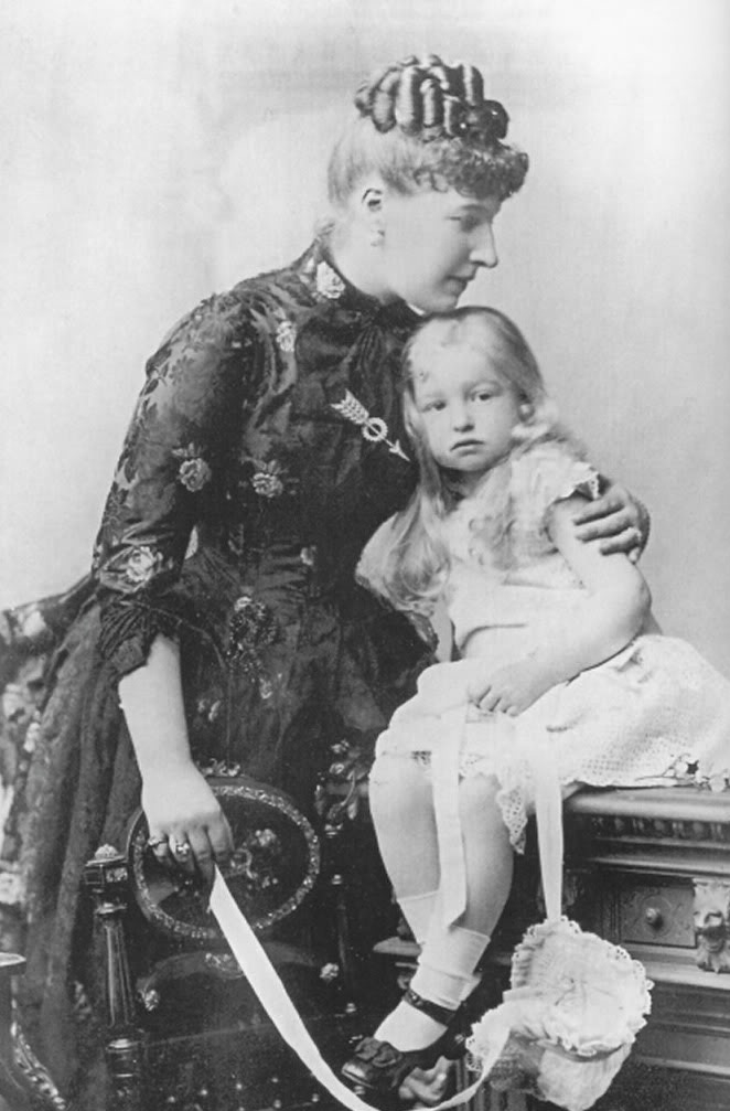 Princess Louise with a child.