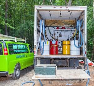 Go Green Spray Foam chemical barrels in truck
