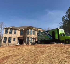 Go Green Spray Foam Truck by house