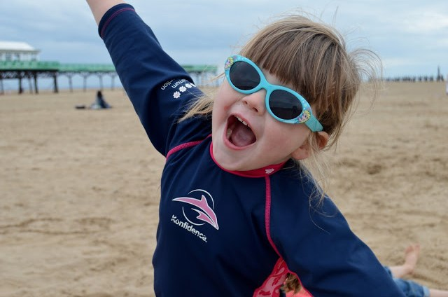 Chloe wearing Konfidence sun protection suit on the beach