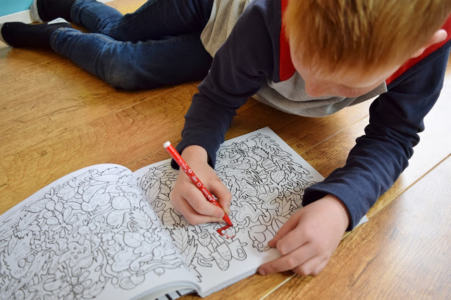 boy colouring in with felt tip
