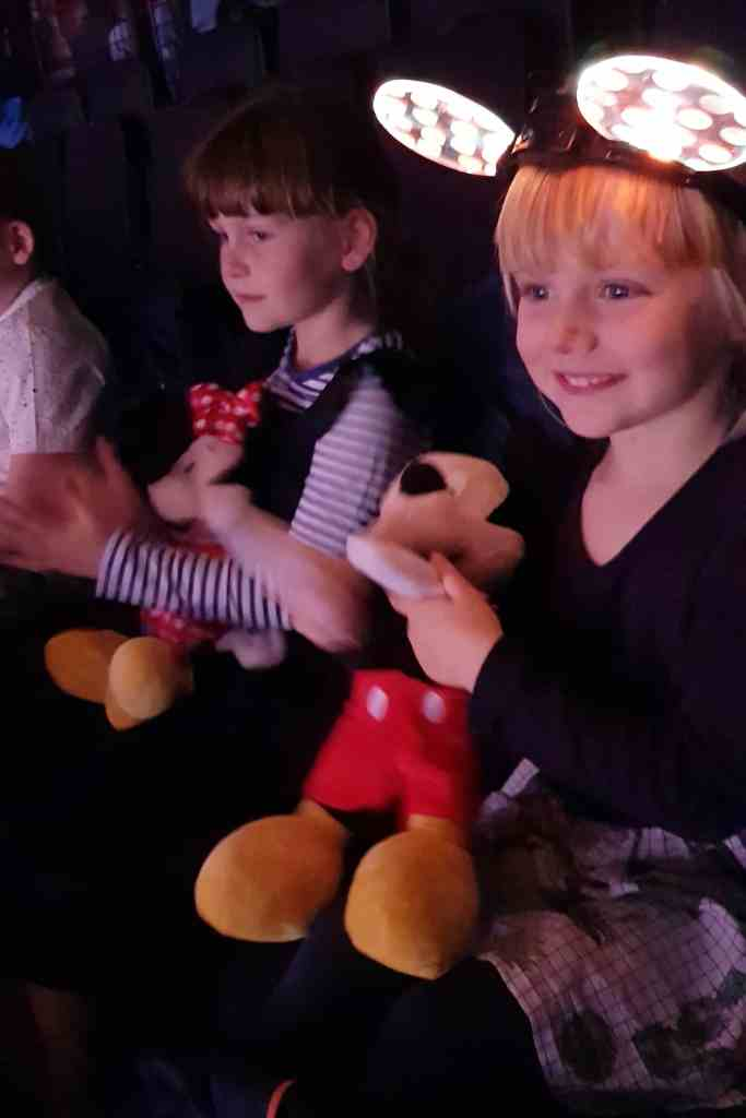 Disney on Ice Dream Big -little girl watching show with smile on her face