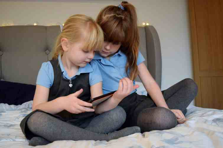 Girls watching a film on tablet
