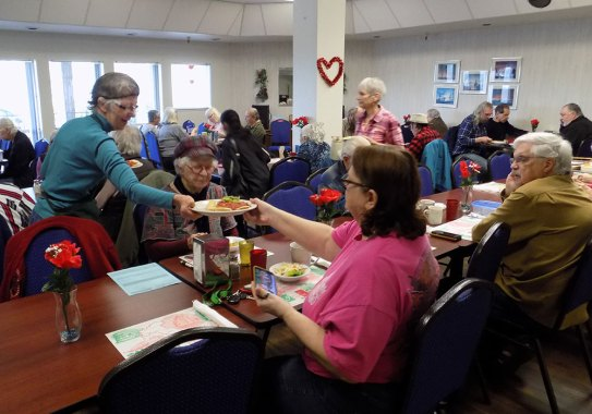 group of seniors having lunch at senior center