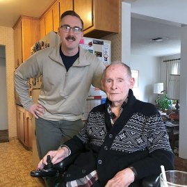 meals on wheels volunteer with senior in wheelchair