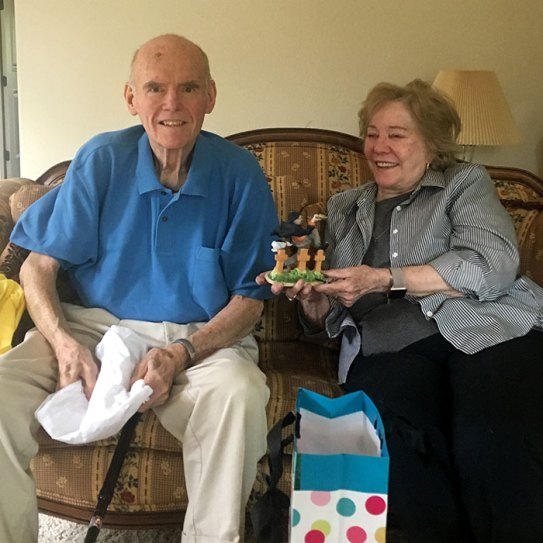 meals on wheels customer with gift from volunteer