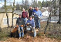 firewood volunteers with chainsaw