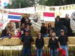 Gold Dust employees and children posing in front of parade float