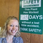 Necia Phillips happily posing with the safety sign.