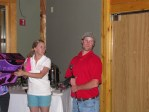 Necia Phillips awarding Matt Thompson with a golf club for Men's Longest Drive at the Gold Dust golf scramble.