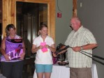 "Tricia Walker and Necia Phillips award Duane ""Sarge"" Preston with a club of his choice for Men's Closest To The Pin."