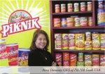 A photo of Alma Dacanay, CEO of Pik Nik Foods, USA in a photo appearing in US Business Executive