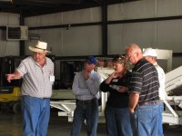 Bill Walker discussing Gold Dust's chipping potatoes with Mike Henard, Tricia (Walker) Hill, Matt Huffman and Joe Dahlen at the 2013 Open House Field Day.