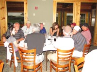 Guests visit at the Pro Shop of the Running Y Ranch golf course for dinner at Gold Dust's 2013 Open House Field Day.