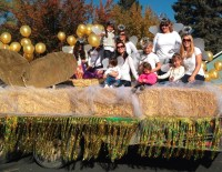 The Gold Dust Potato Processors office staff posing on their Klamath Basin Potato Festival float before the parade begins.