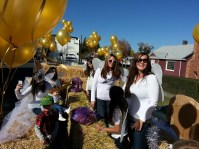 The Gold Dust office staff and kids wait for the Potato Festival parade to begin in Merrill, Oregon.