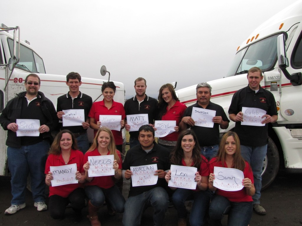 The Gold Dust Staff posed with two potato trucks for the 2013 company Christmas cards.