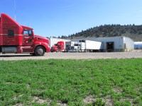 Semi-trucks wait to be loaded with chipping potatoes at Gold Dust's Malin, Oregon, packing shed.
