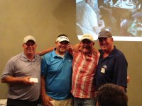 Ed Staunton, Jared Marshall, John Walker and Mike Machurek smile for their 1st place team picture at Gold Dust's 2014 Open House Field Day dinner.