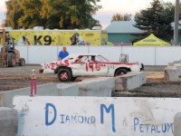 Don Sconce drives the #19 derby car into the arena at the 2014 Tulelake Butte Valley Fair demolition derby.