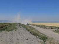 A potato trucks kicks up dust on a dirt road on the Tule Lake National Wildlife Refuge near the Oregon-California border.